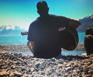Trying to come up with a new song on the shore of Lake Albert, New Zealand.