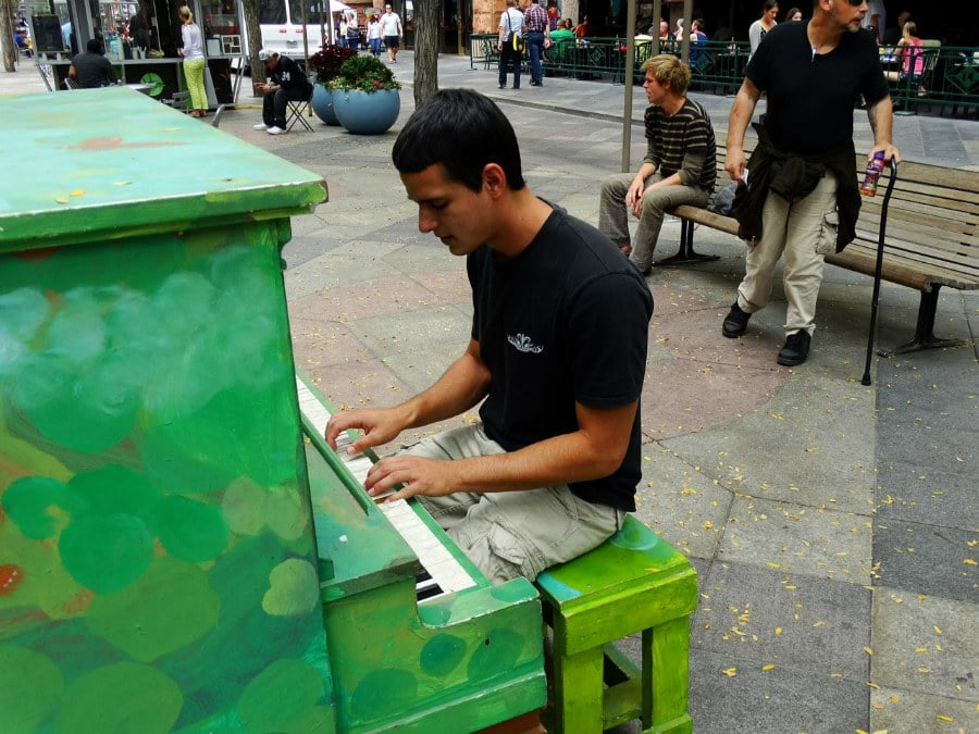 Downtown Denver, Colorado. Art covered pianos all over the place free for public use!