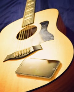 My iPhone 6 and my Washburn WD10 . Smartly combining your powerful smartphone with your guitar can take you much further as a musician, so take advantage of these great apps!
