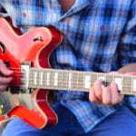 Guitar Playing: The Pros and Cons of Using a Pick Vs. Fingers